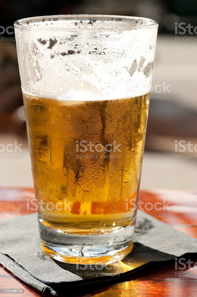 Fresh Pint of cold Beer royalty-free stock photo