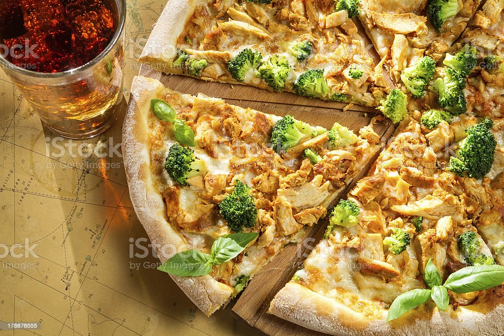 Fresh pizza made of broccoli, chicken and basil royalty-free stock photo