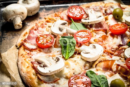 istock Fresh pizza with mushrooms. 901441110