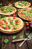 Hot Italian pizza on wooden table