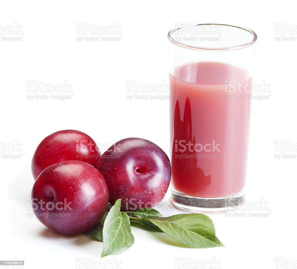 Fresh plums and prune juice isolated on white stock photo