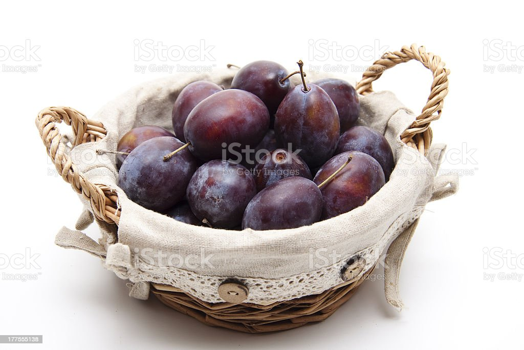 Fresh plums in the basket royalty-free stock photo