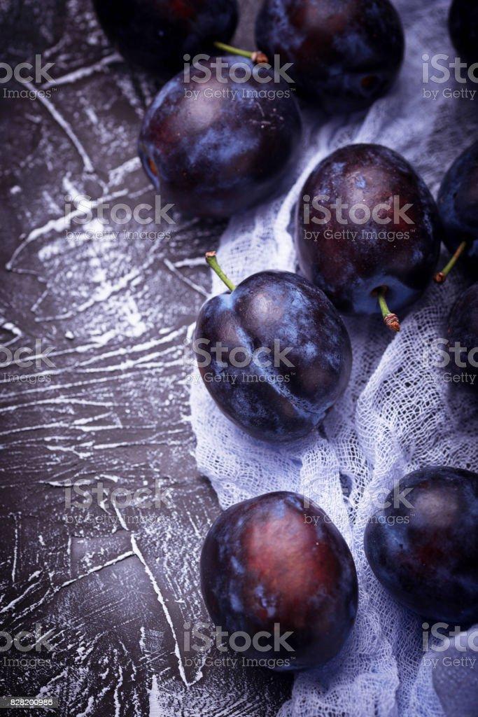 Fresh plums on concrete background stock photo