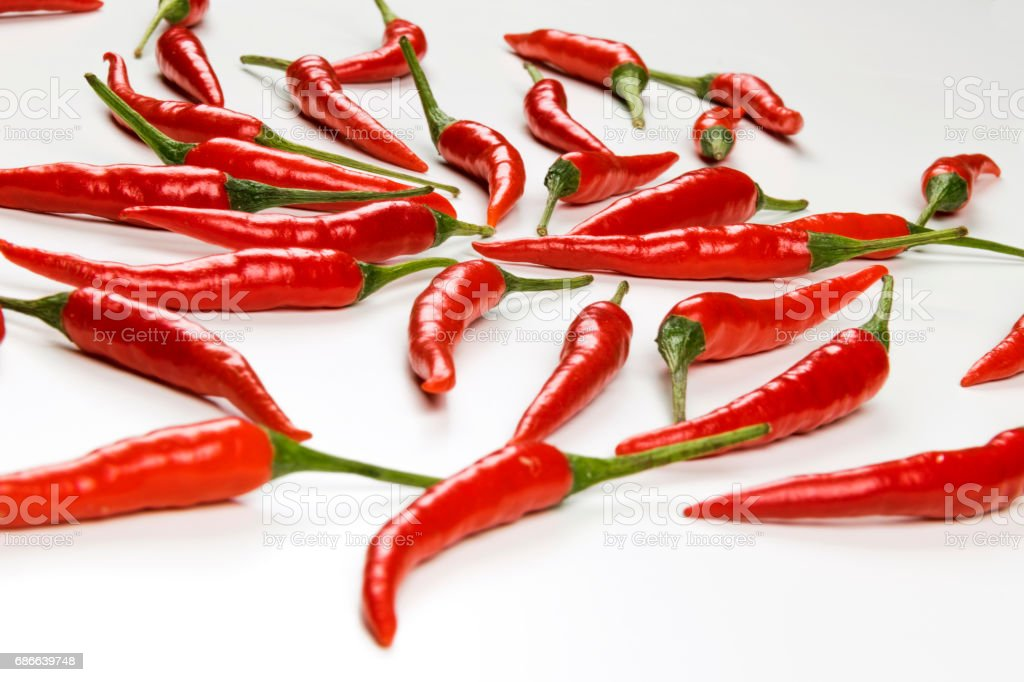 Fresh pods of red chili peppers on white background, close up royalty-free stock photo