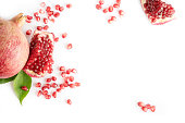 Fresh Pomegranate fruit with the seeds on white isolated background