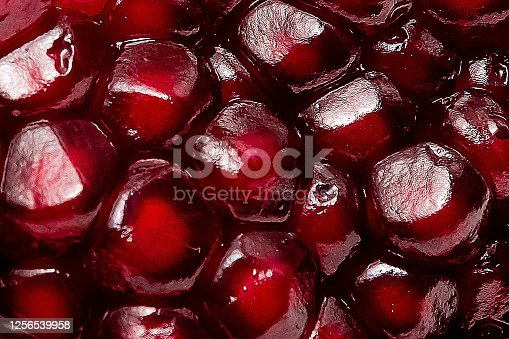 fresh pomegranate seeds macro close-up in drops