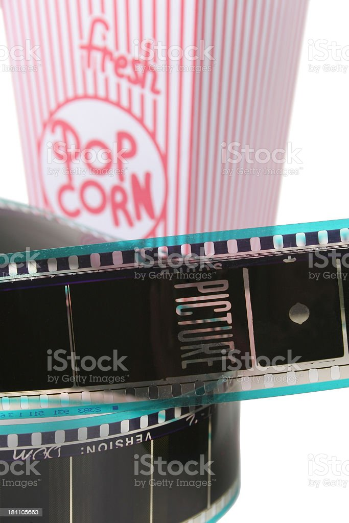 Fresh popcorn and 35mm film reel royalty-free stock photo