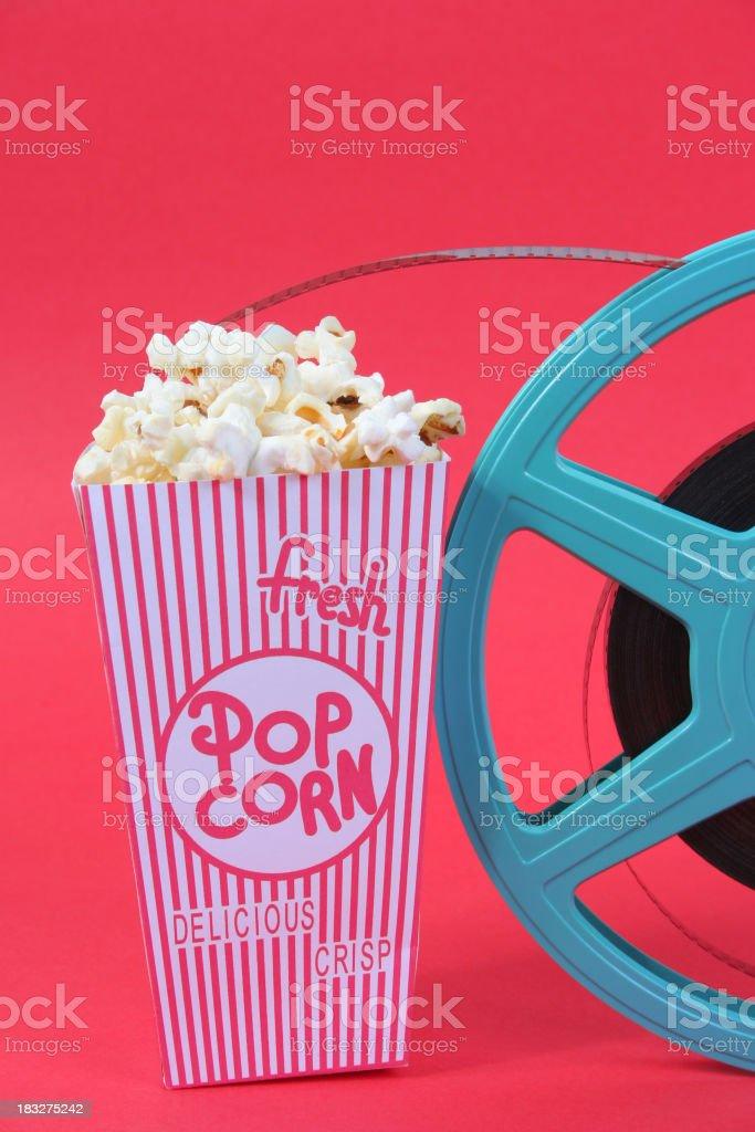 Fresh popcorn and reel stock photo