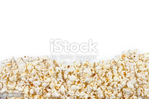 Fresh popcorn on a white plate with clipping path. Top view.