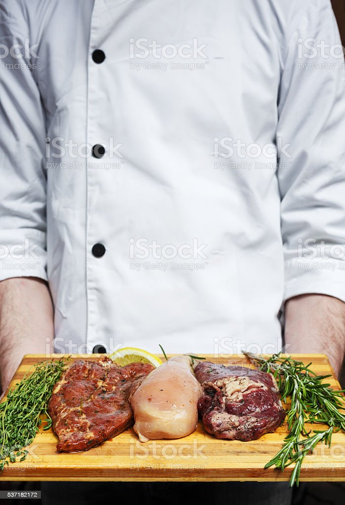 fresh pork, beef and chicken meat on a cutting board stock photo