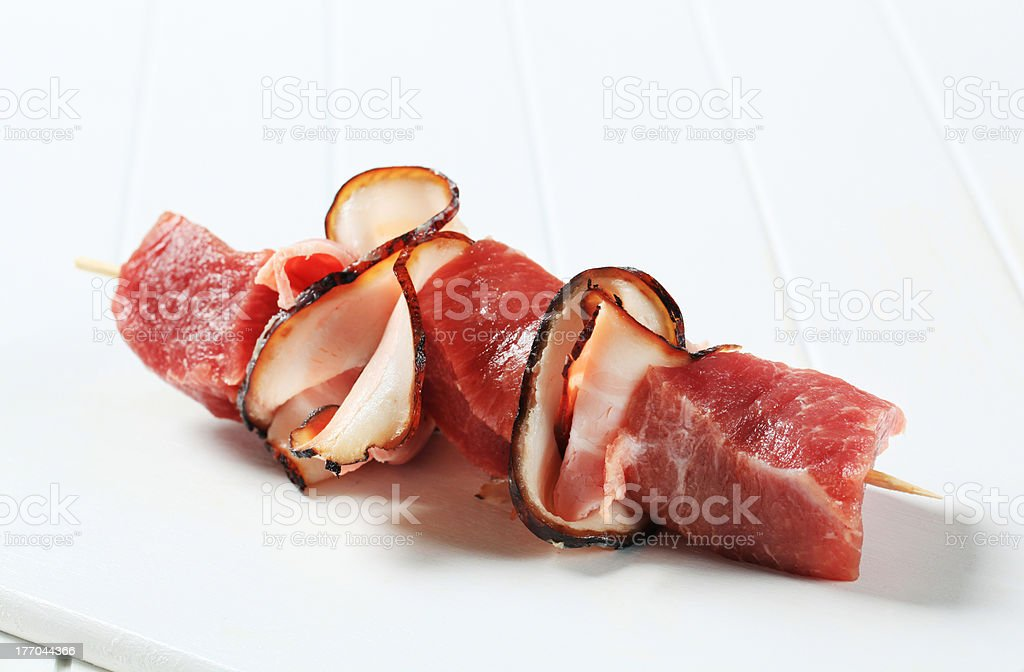 Fresh pork chunks and bacon on stick royalty-free stock photo