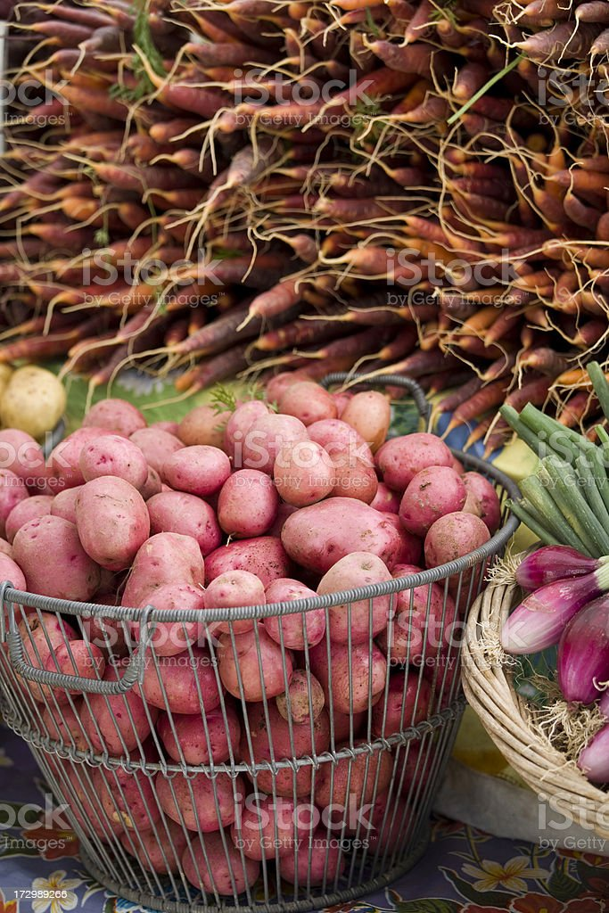 Fresh Potatoes and Carrots at the Farmers Market royalty-free stock photo