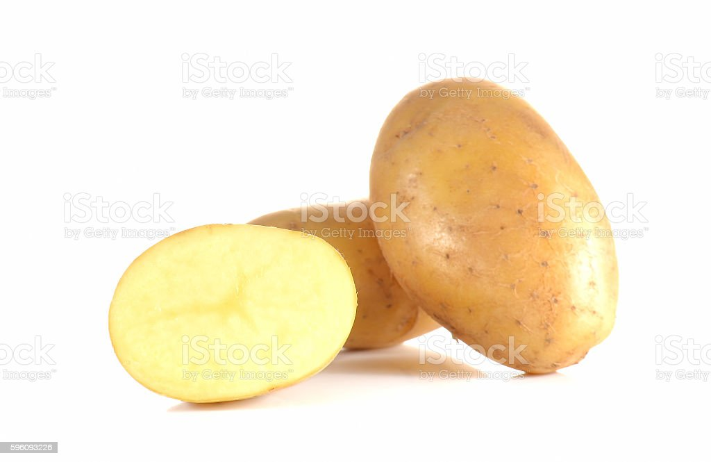 Fresh potatoes full ball and cut half on white background. Lizenzfreies stock-foto