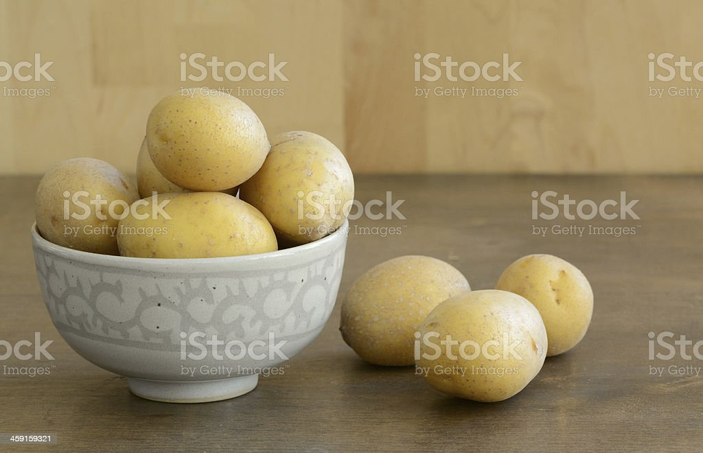 Fresh potatoes in a bowl royalty-free stock photo