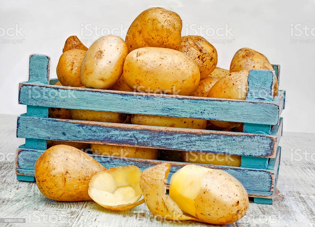 Fresh potatoes in a wooden box stock photo