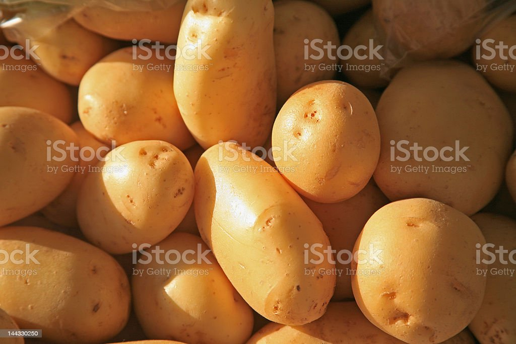 fresh potatoes on market royalty-free stock photo