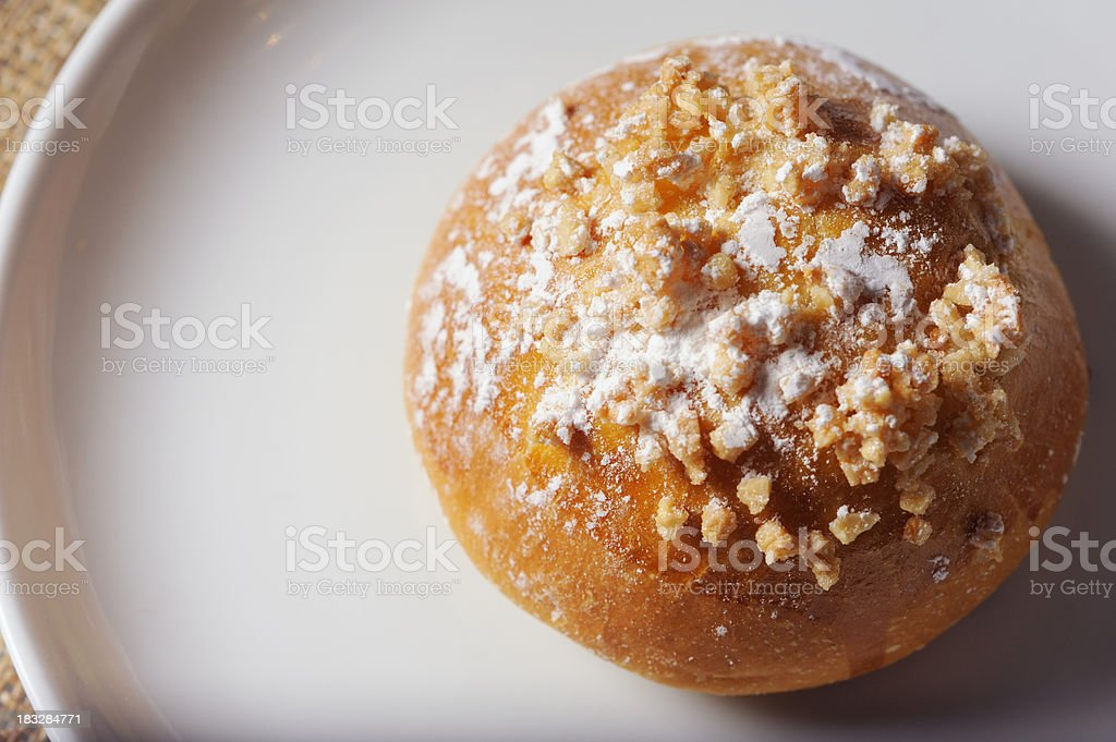 Fresh Praline Brioche Sits on a Plate stock photo