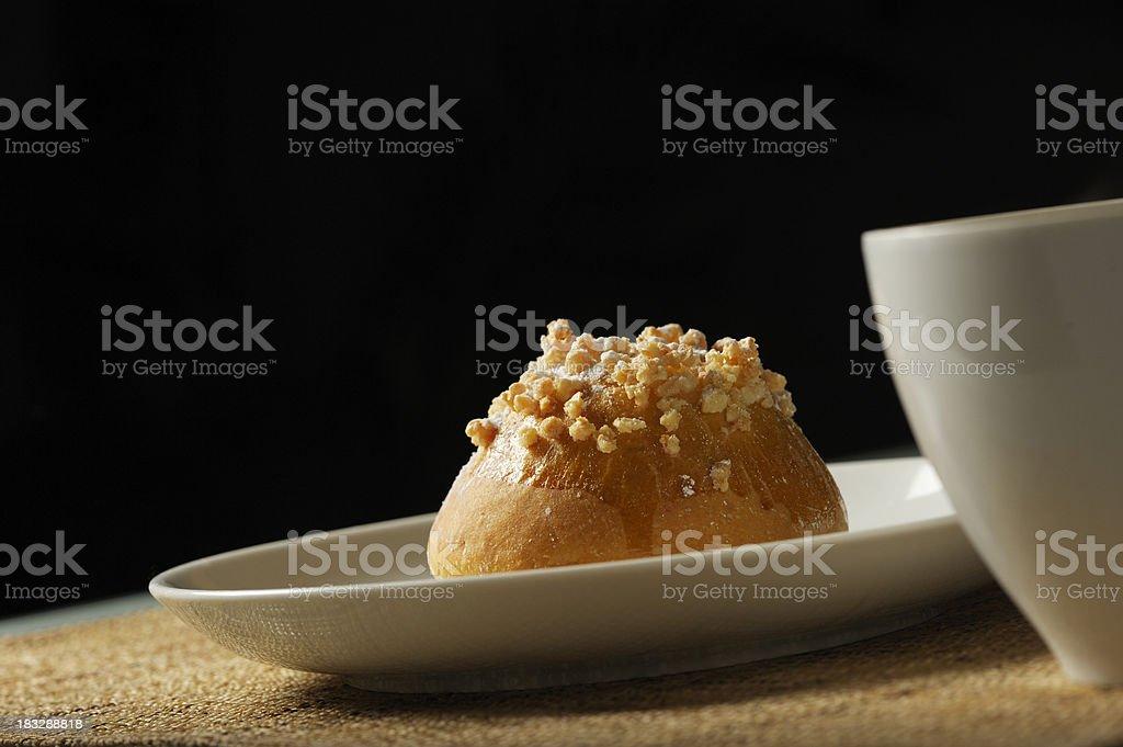 Fresh Praline Brioche Sits on a Plate royalty-free stock photo