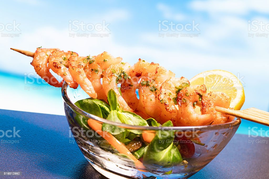 fresh prawns with salad and sea views stock photo