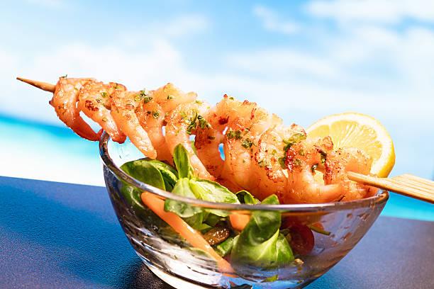 fresh prawns with salad and sea views stock photo