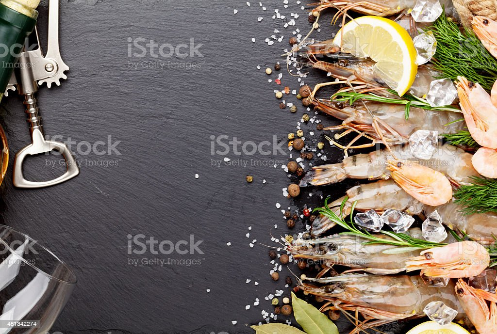 Fresh prawns with spices and white wine stock photo