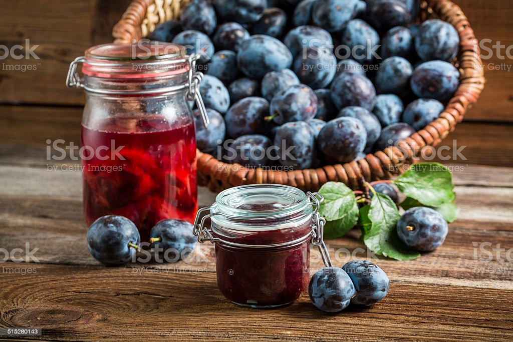 Fresh preserves from plum in the pantry stock photo