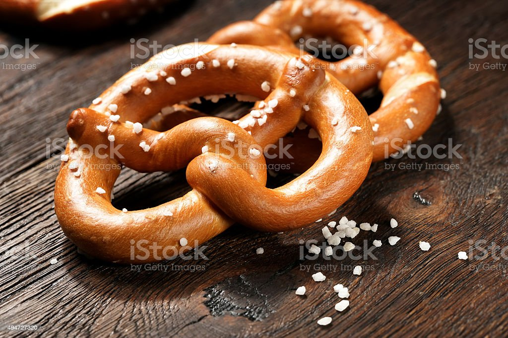 Fresh pretzels with sea salt close-up stock photo