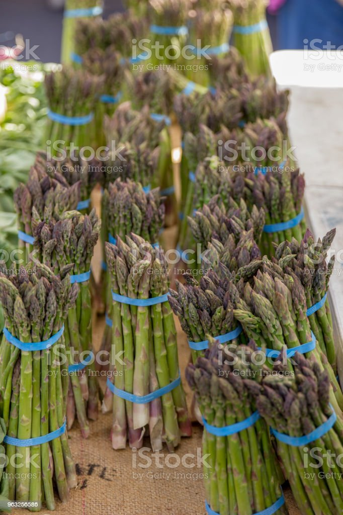 Local produce - asparagus, onions, radish, cilantro and mint are sold...