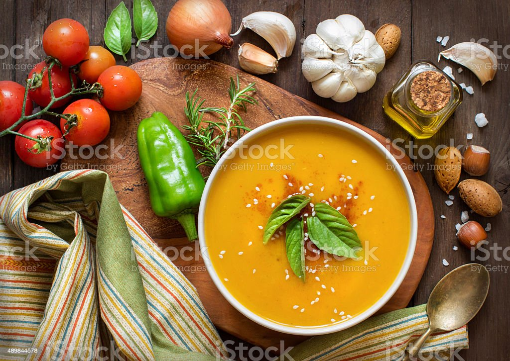 Fresh pumpkin soup with and vegetable stock photo