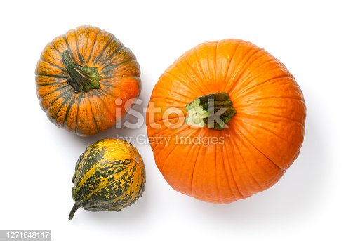 Fresh pumpkins isolated over white background. Top view