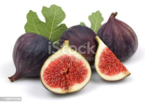 878725126 istock photo Fresh purple fig fruit and slice with leaf isolated 1166976288