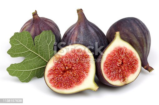 878725126 istock photo Fresh purple fig fruit and slices with leaf isolated 1138157638