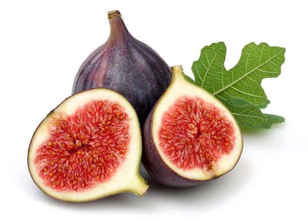 fruits frais figue violette et des tranches avec feuille - figue photos et images de collection
