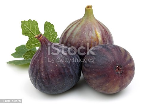878725126 istock photo Fresh purple fig fruits with leaf isolated 1138157575