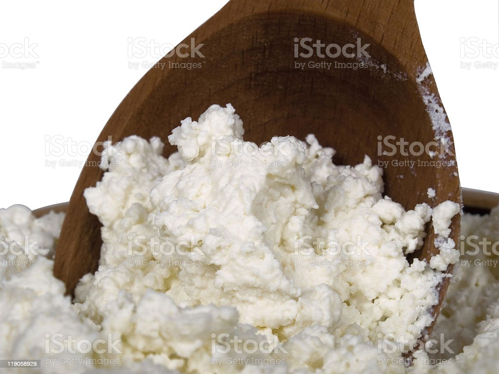 fresh quark  is in a wooden spoon stock photo