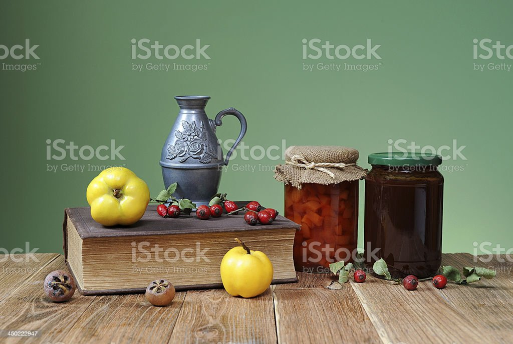 Fresh quince jam and books stock photo