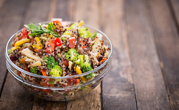 fresh quinoa salad in the bowl - quinoa stock photos and pictures