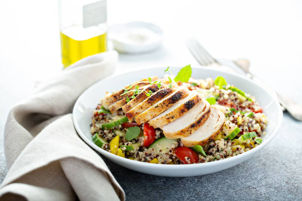Fresh quinoa tabbouleh salad with grilled chicken stock photo