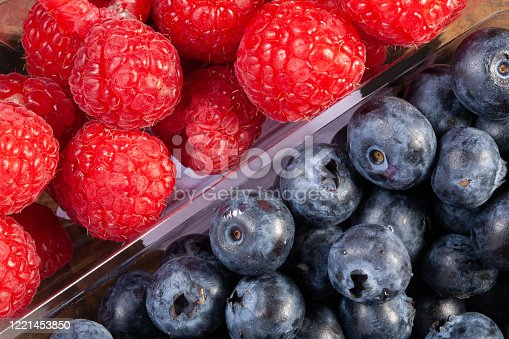 fresh raspberries and blueberries. Close-up view from above