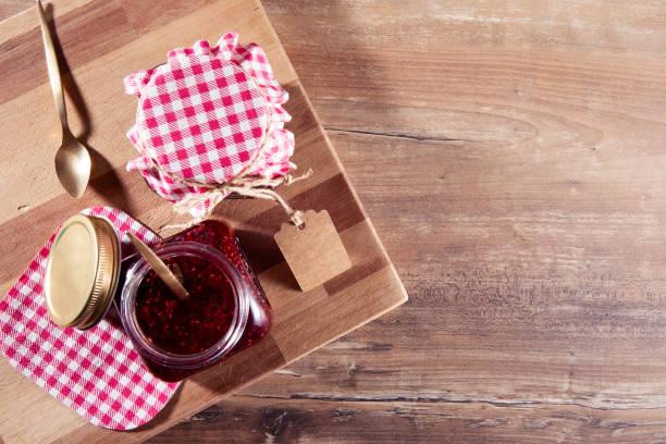 Fresh Raspberry Jam on Brown Wooden Table stock photo