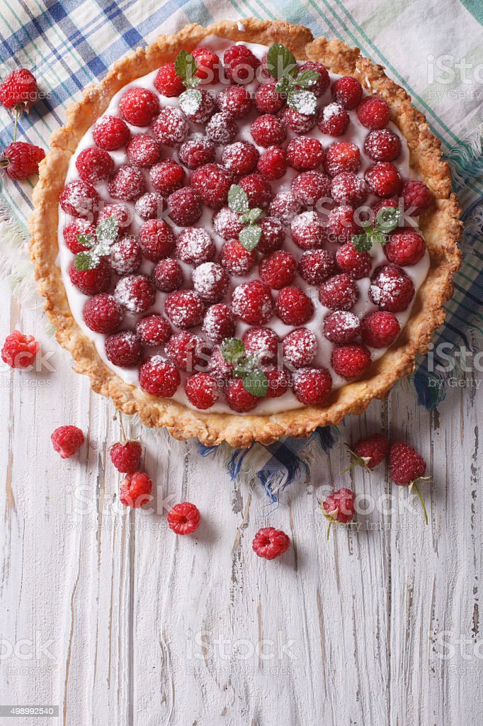 Fresh raspberry tart with cream cheese. vertical top view stock photo