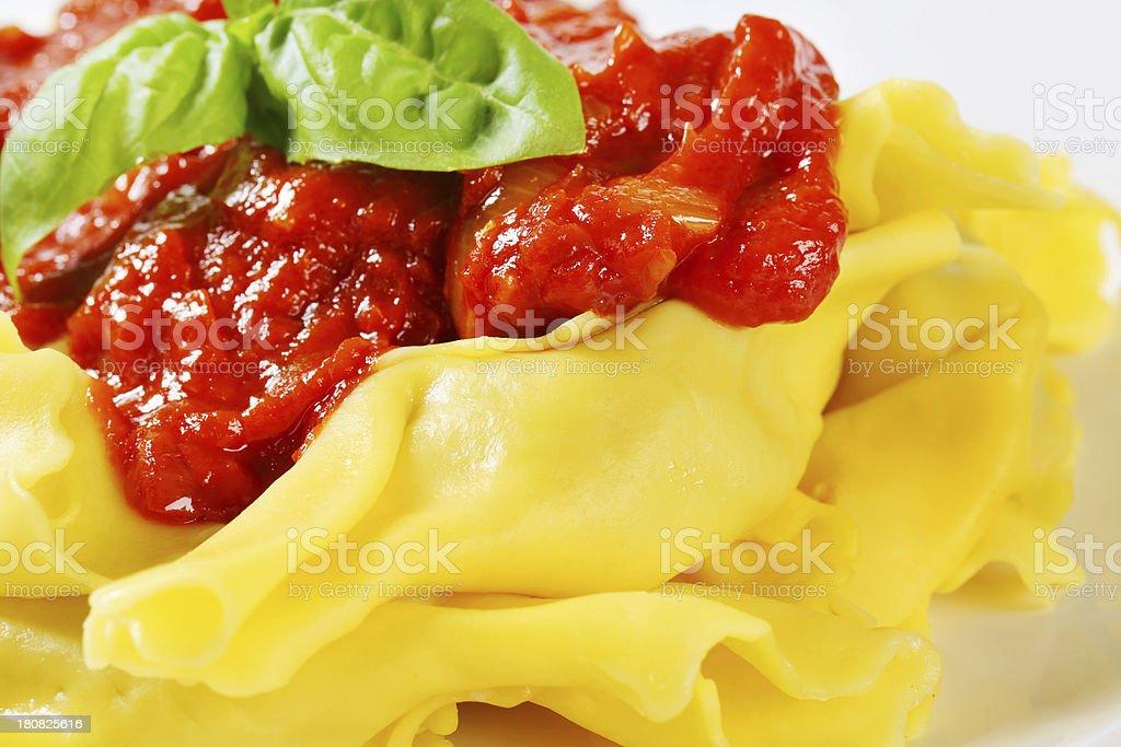 Fresh ravioli pasta with tomato sauce royalty-free stock photo
