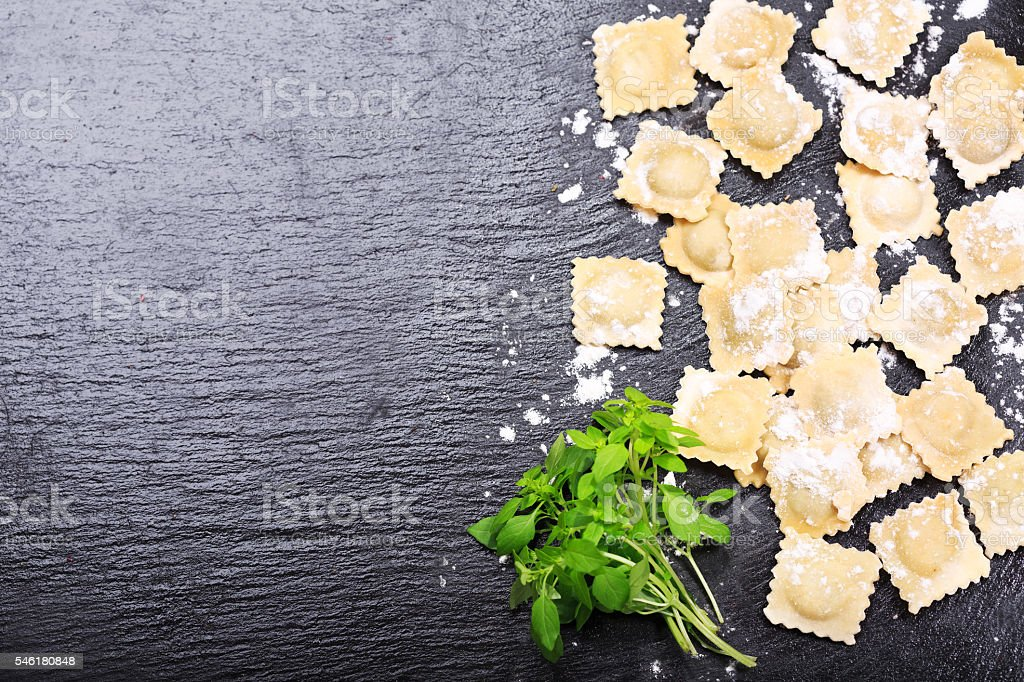fresh ravioli with green basil stock photo