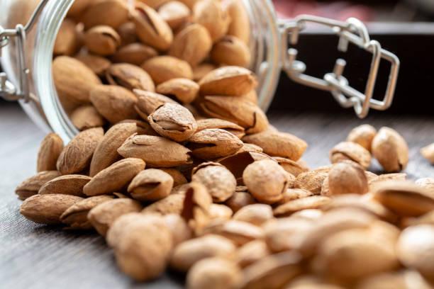 fresh raw almonds stock photo