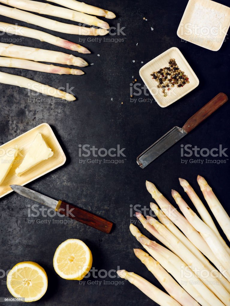 Fresh raw asparagus with potatoes, eggs, butter, lemon, pepper and salt ready to cook. - Royalty-free Asparagus Stock Photo