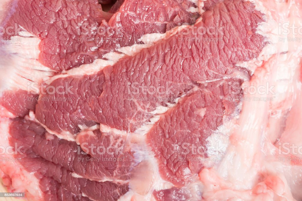 fresh raw beef meat slices on wooden for cooking stock photo