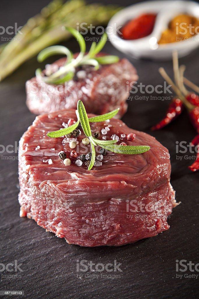 Fresh raw beef steak on black stone stock photo
