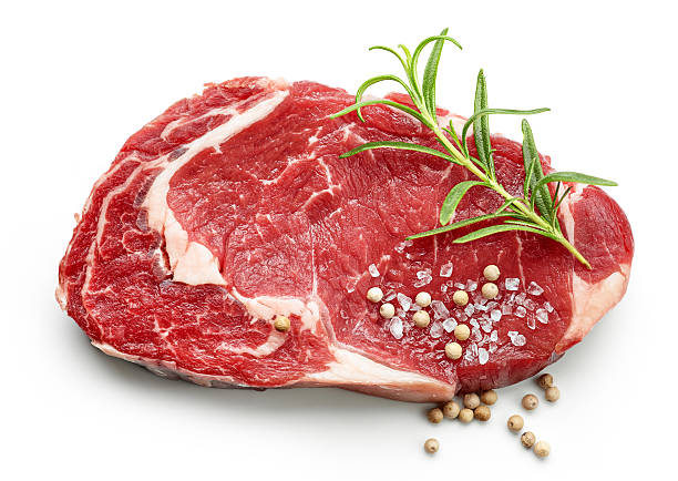 fresh raw beef steak with spices stock photo