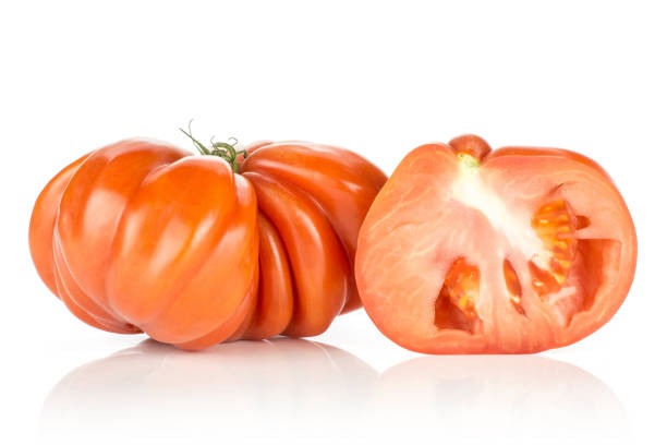 Fresh raw beef tomato isolated on white picture id962150870?b=1&k=6&m=962150870&s=612x612&w=0&h=suiwf kesmqu6lytla1mfidx13qi6wphnfhh eiihbm=