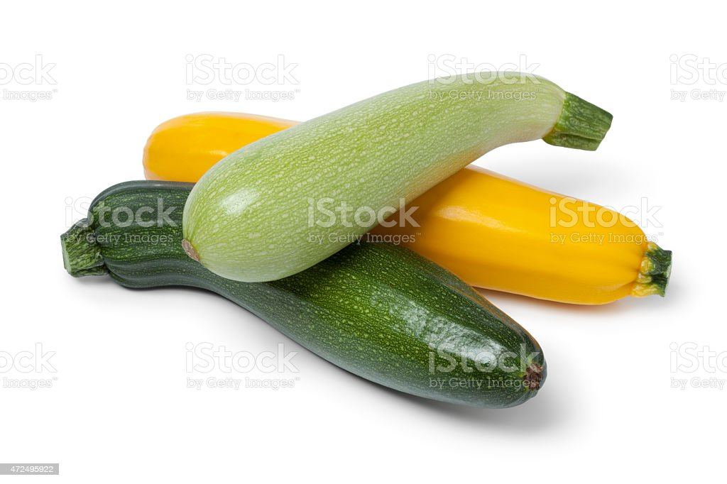 Fresh raw courgettes in different colors stock photo